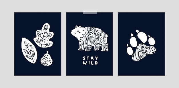 Set with childish cards or poster with bear, paw, plants. stay wild. nursery prints