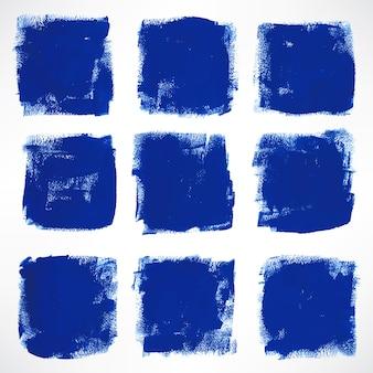 9つのグランジインク手描きの青い正方形で設定