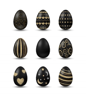 Set with realistic black eggs with golden patterns