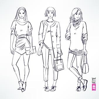 3人の美しいファッションモダンスケッチガールとセット。手描きイラスト