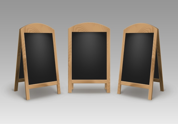Set of wooden empty blank advertising street sandwich stands sidewalk signs black menu boards isolated on background