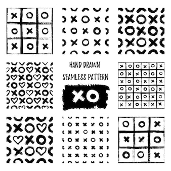 Set of xoxo seamless patterns. vector abstract backgrounds with ink brush strokes. monochrome scandinavian hand drawn print. grunge texture with simbols of zero, cross and heart.