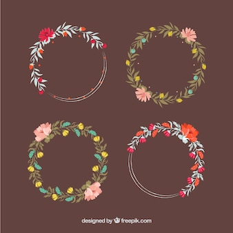 Several beautiful hand-drawn floral wreaths in vintage style