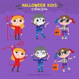 Several children in halloween costumes