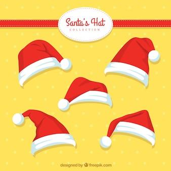 여러 손으로 그린 산타 클로스 모자