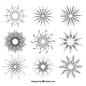 Several hand drawn sunburst and stars