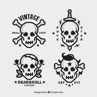 フラットなデザインのいくつかの頭蓋骨のロゴ