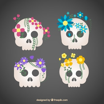 Several skulls with colored flowers