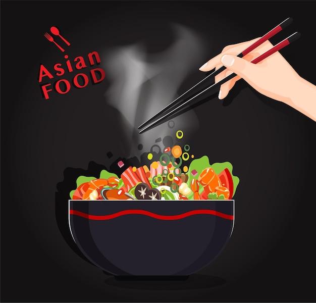 Shabu shabu and sukiyaki in hot pot at restaurant,  hand holding chopsticks eating shabu