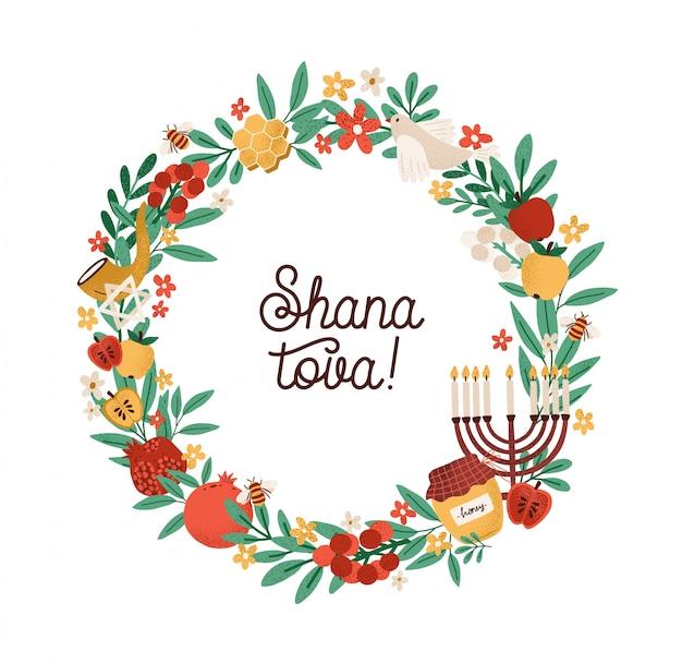 Shana tova phrase inside round frame or wreath made of leaves, shofar horn, menorah, honey, berries, apples, pomegranates.