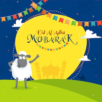 Sheep indicating towards text eid-al-adha