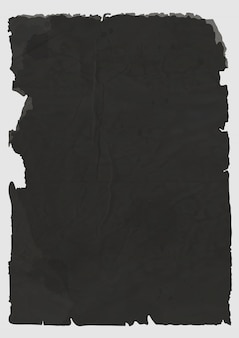 Sheet of black torn paper
