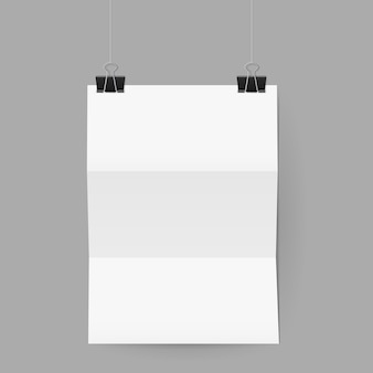 Sheet of paper folded in three hanging on paper clips