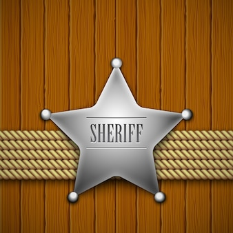Sheriff's badge on a wood