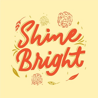 Shine bright quote lettering with flowers
