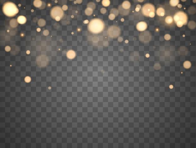 透明な背景に分離された輝くボケ光る粒子が分離された金色のボケライト...