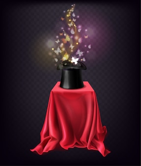 Shining butterflies flying out from black top hat standing on stand covered with red silk cape