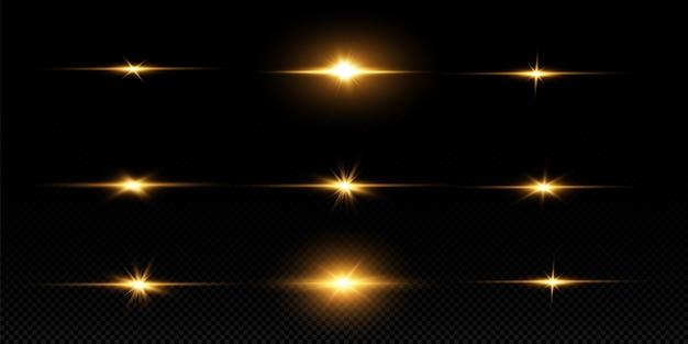 Сияющие золотые звезды, изолированные на черном фоне. эффекты, блики, линии, блеск, взрыв, золотой свет. векторная иллюстрация
