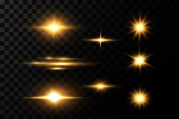 Сияющие золотые звезды, изолированные на черном фоне.