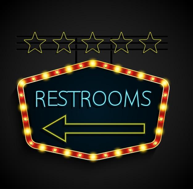 Shining retro light banner restrooms on a black background