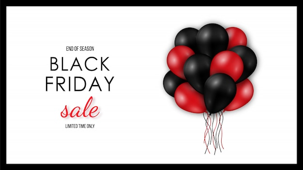 Shiny black and red balloons on white background.