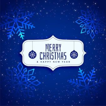 輝く青色の輝きのクリスマスの背景