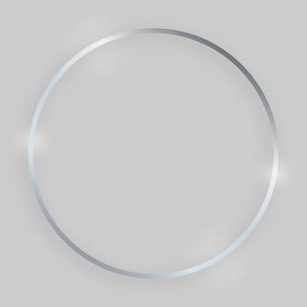 輝く効果のある光沢のあるフレーム。灰色の背景に影付きのシルバーの丸いフレーム。ベクトルイラスト
