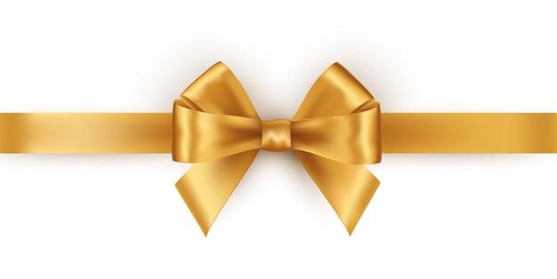 白で隔離される光沢のあるゴールドのサテンリボン