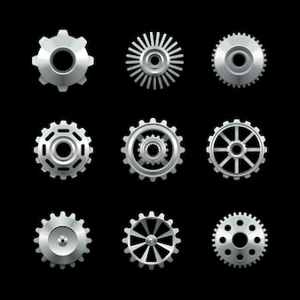 Shiny metal gears set isolated on dark background