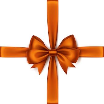 光沢のあるオレンジ色のサテンの弓とリボンの上面図クローズアップ孤立