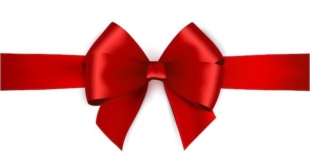 白い背景の赤いリボンとリボンに光沢のある赤いサテンリボン。