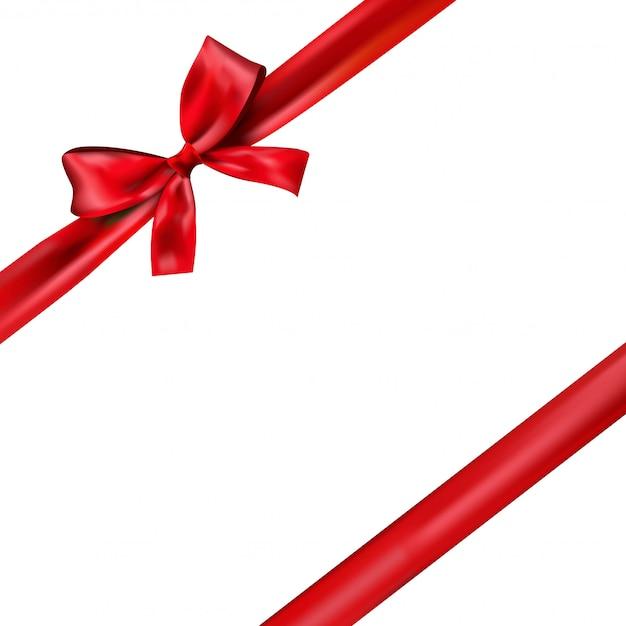 Сияющая красная атласная лента на белом фоне. красный подарочный бант и лента.