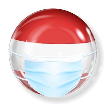 オーストリアの国旗の色にコロナウイルスから保護するための医療用マスクが付いた光沢のある球体