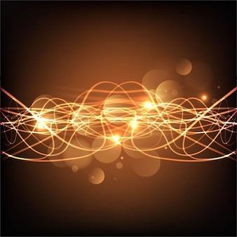 金色のラインを持つ光沢のある波状の背景