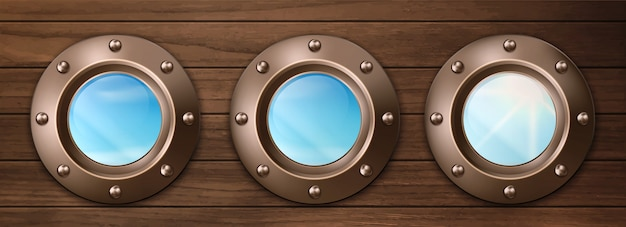 Ship portholes on wooden wall with sky view