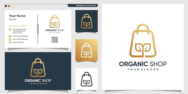 Логотип магазина с органической темой в стиле арт и шаблоном дизайна визитной карточки