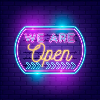 Shop with we are open sign in neon lights