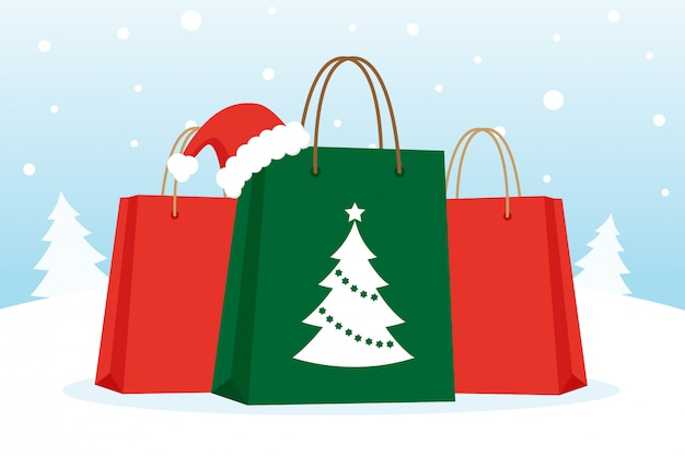 Shopping bags with christmas hat on the snow