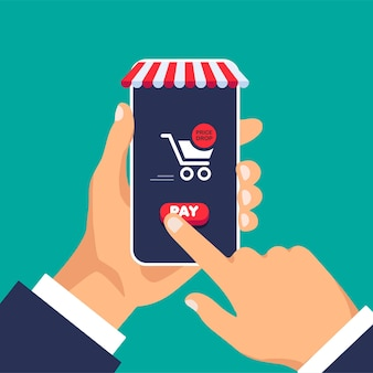 Shopping cart with red pay button online ordering notification on phone screen home shopping