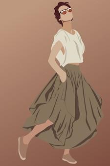茶色のロングスカート、靴、サングラス、白いtシャツを着た、短い髪の魅力的なブルネット。彼女のスタイルを示す