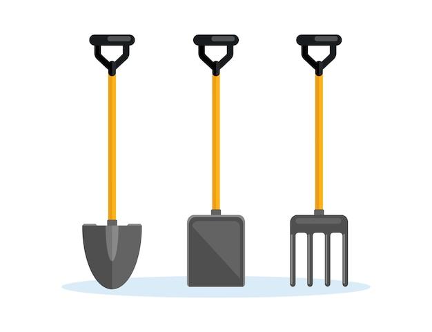 シャベル、スペード、熊手、背景にファームフォーク。園芸工具、掘削要素、農家向け機器。春の仕事。