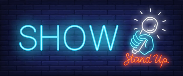 Show neon sign. glowing stand up text and hand with microphone