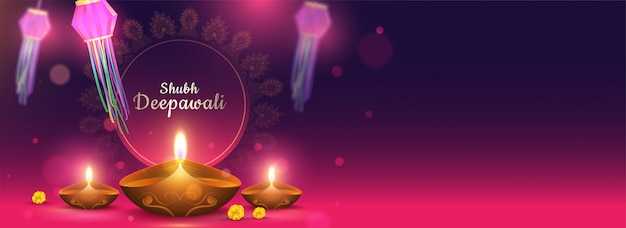Shubh deepawali header or banner with illuminated oil lamps (diya) and bokeh effect on purple