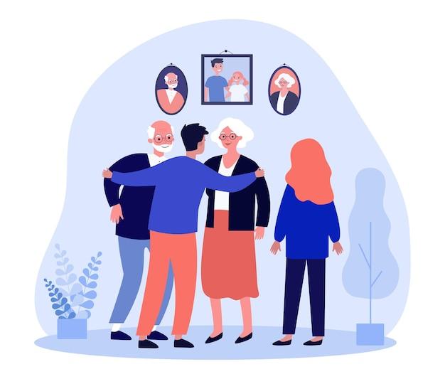 가족 초상화 앞에서 부모와 이야기하는 형제 자매