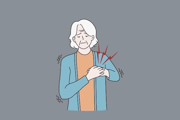 病気の老婆は心臓発作に苦しんで気分が悪い