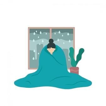 うつ病の病気の女性は毛布で覆われています