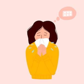 Больная женщина чихает в платок