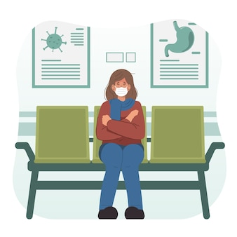 Sick woman waiting for the doctor in hospital lobby