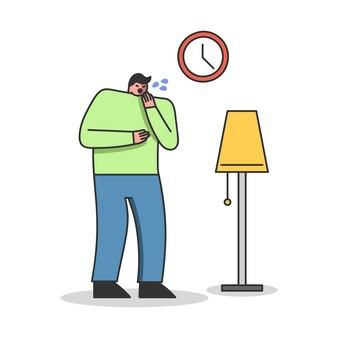 아픈 젊은 남자가 가슴 통증을 느끼는 기침을하고 있습니다.