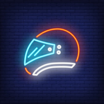 Side view of biker helmet on brick background. neon style